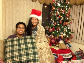 Here we are during our first Noche Buena together at my parents' house. We had pozole and opened gifts at midnight.